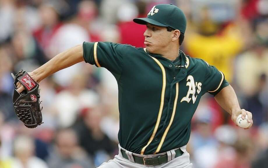 Oakland Athletics' Tommy Milone pitches in the first inning of a baseball game against the Boston Red Sox in Boston, Saturday, May 3, 2014. (AP Photo/Michael Dwyer)