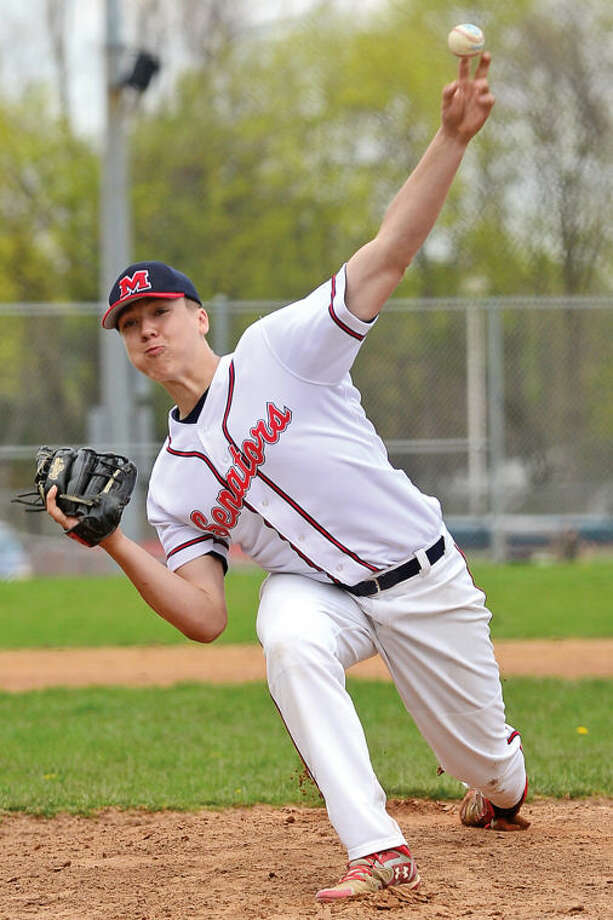 Hour photo / Erik Trautmann Pitcher #17 throws heat during the Seantors game against New Canaan Saturday.