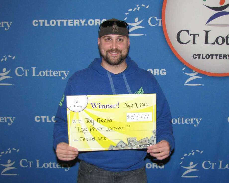 """Jay Thaxter won $57,777 on a """"Fire and Ice"""" lottery ticket. His wife, who grabbed one of his tickets lost. But the two will share the prize. """"We've been looking to buy a house the last couple months, so this will definitely help with that,""""Jay Thaxter said. (Photo: CT Lottery)"""