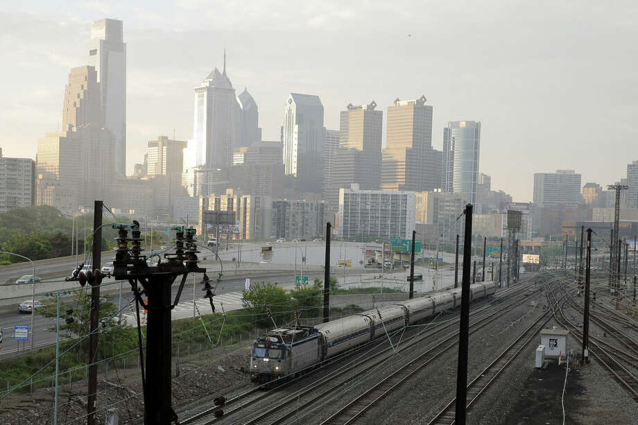 An Amtrak train travels northbound from 30th Street Station, Monday, May 18, 2015 in Philadelphia. Amtrak's Northeast Corridor trains resumed service Monday following last week's deadly derailment that killed eight people and injured more than 200 others. (AP Photo/Matt Slocum)