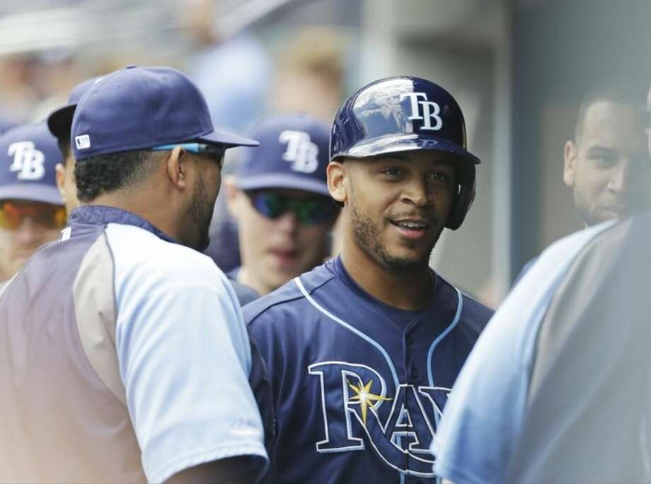 Tampa Bay Rays' Desmond Jennings celebrates with teammates after hitting a home run during the first inning of a baseball game against the New York Yankees Saturday, May 3, 2014, in New York. (AP Photo/Frank Franklin II)