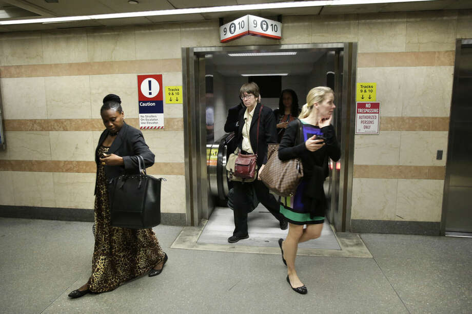 Amtrak passengers arrive in New York's Penn Station from Philadelphia, Monday, May 18, 2015. Amtrak trains began rolling on the busy Northeast Corridor early Monday, the first time in almost a week following a deadly crash in Philadelphia. (AP Photo/Mark Lennihan)