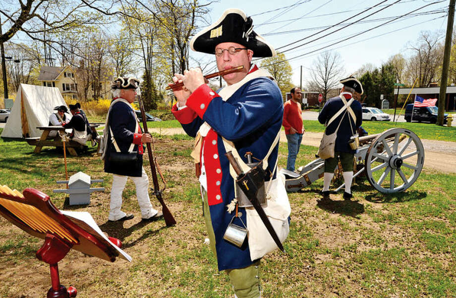 Revolutionary War re enactor Erik Paul plays the fife during the Wilton Historical Society Barn Raising Day Saturday in Wilton.