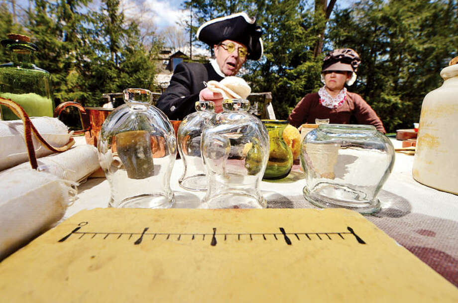 Ted St. Amand displays Revolutionary war era medical tools during the Wilton Historical Society Barn Raising Day Saturday in Wilton.