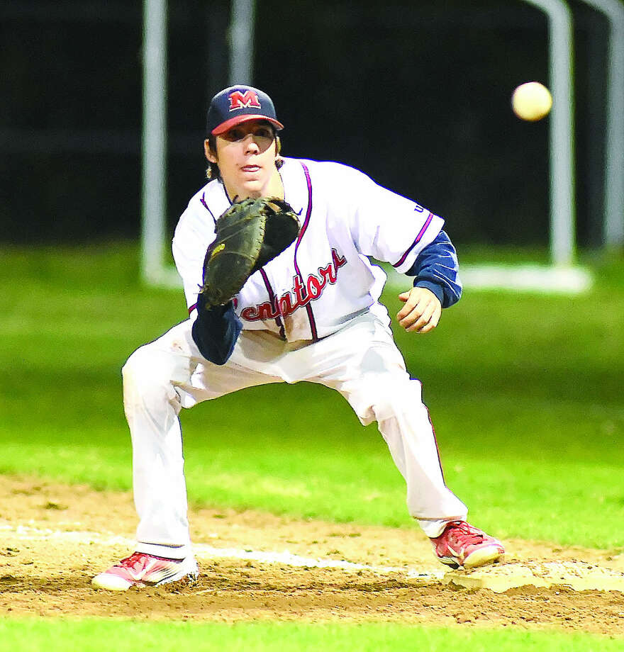 Hour photo/John Nash - Brien McMahon first baseman Matt Galyas waits for a throw from a teammate on an infield putout vs. Greenwich on Monday night in Norwalk.