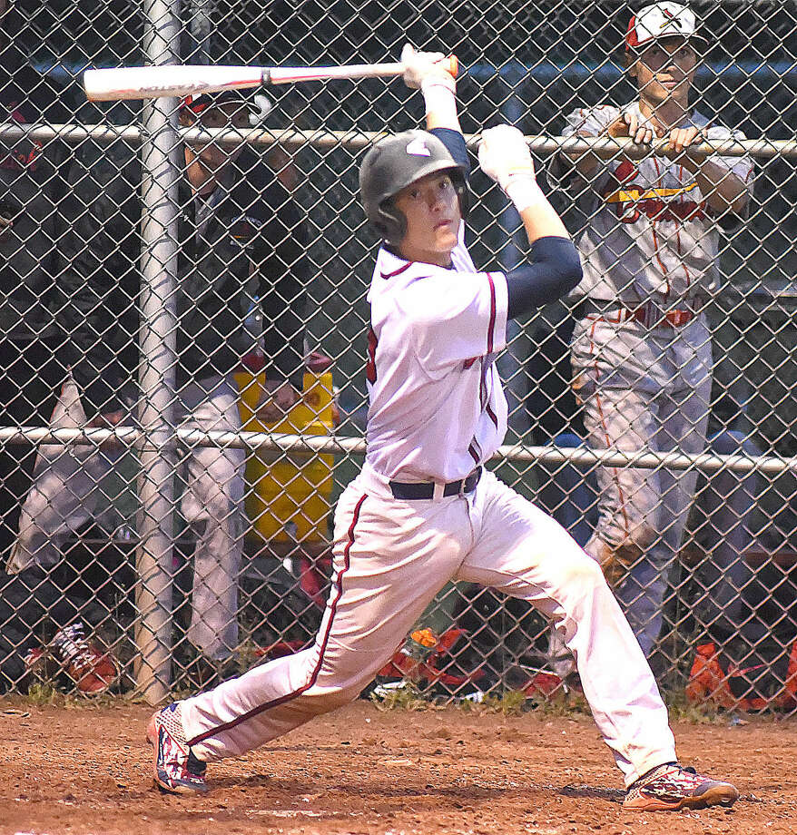 Hour photo/John Nash - Brien McMahon batter Hunter Dumas watches his hit sail toward right field during Monday night's FCIAC baseball game against Greenwich in Norwalk.