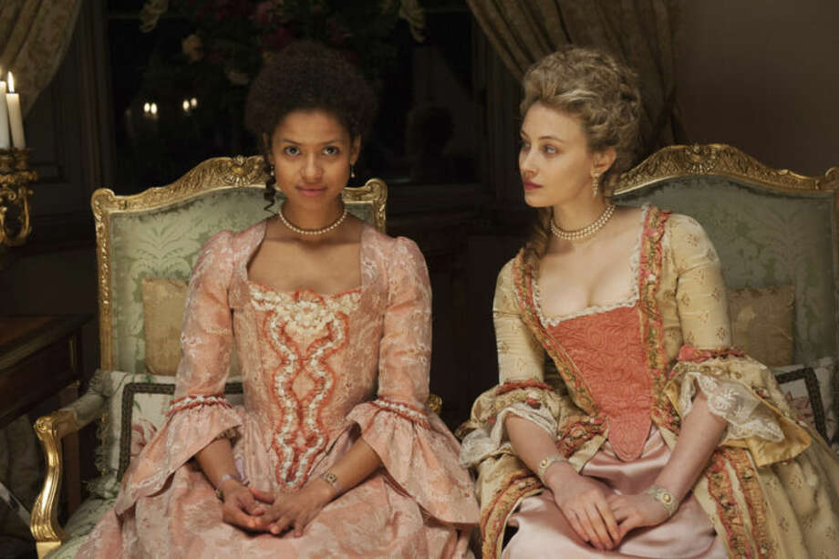 "This photo released by Fox Searchlight shows Gugu Mbatha-Raw, left, as Dido Elizabeth Belle and Sarah Gadon as Lady Elizabeth Murray, in a scene from the film, ""Belle."" The movie releases in US theaters on Friday, May 2, 2014. (AP Photo/Fox Searchlight, David Appleby)"