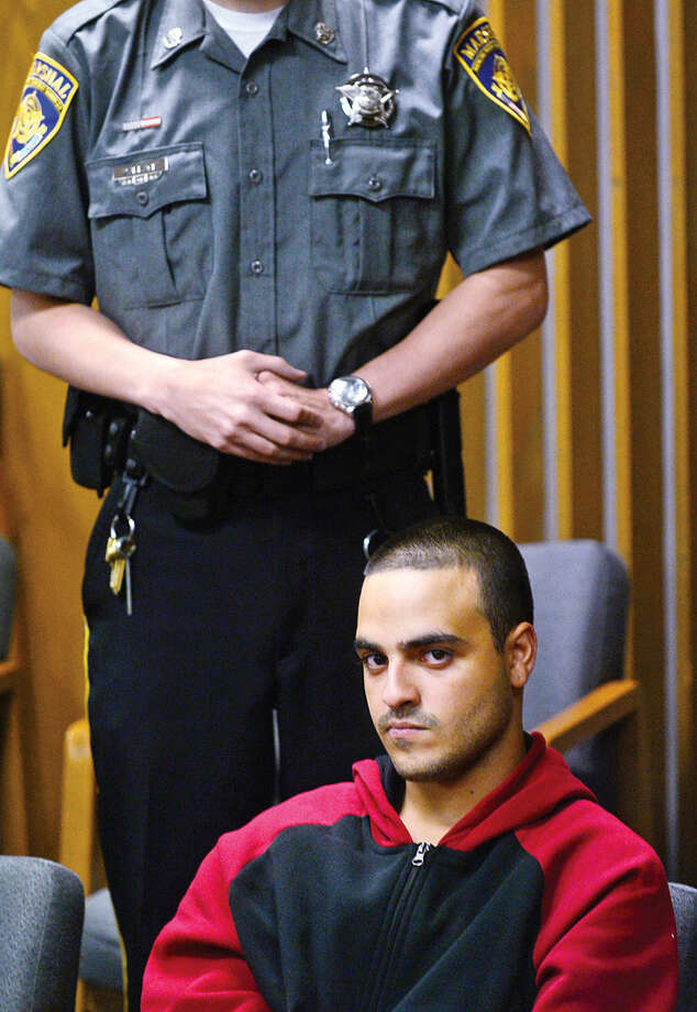 Hour photo / Erik Trautmann Jorge E. Chiclana of Bridgeport is arraigned at Norwalk Superior Court Tuesday for his arrest yesterday in connection with the death of his infant son.