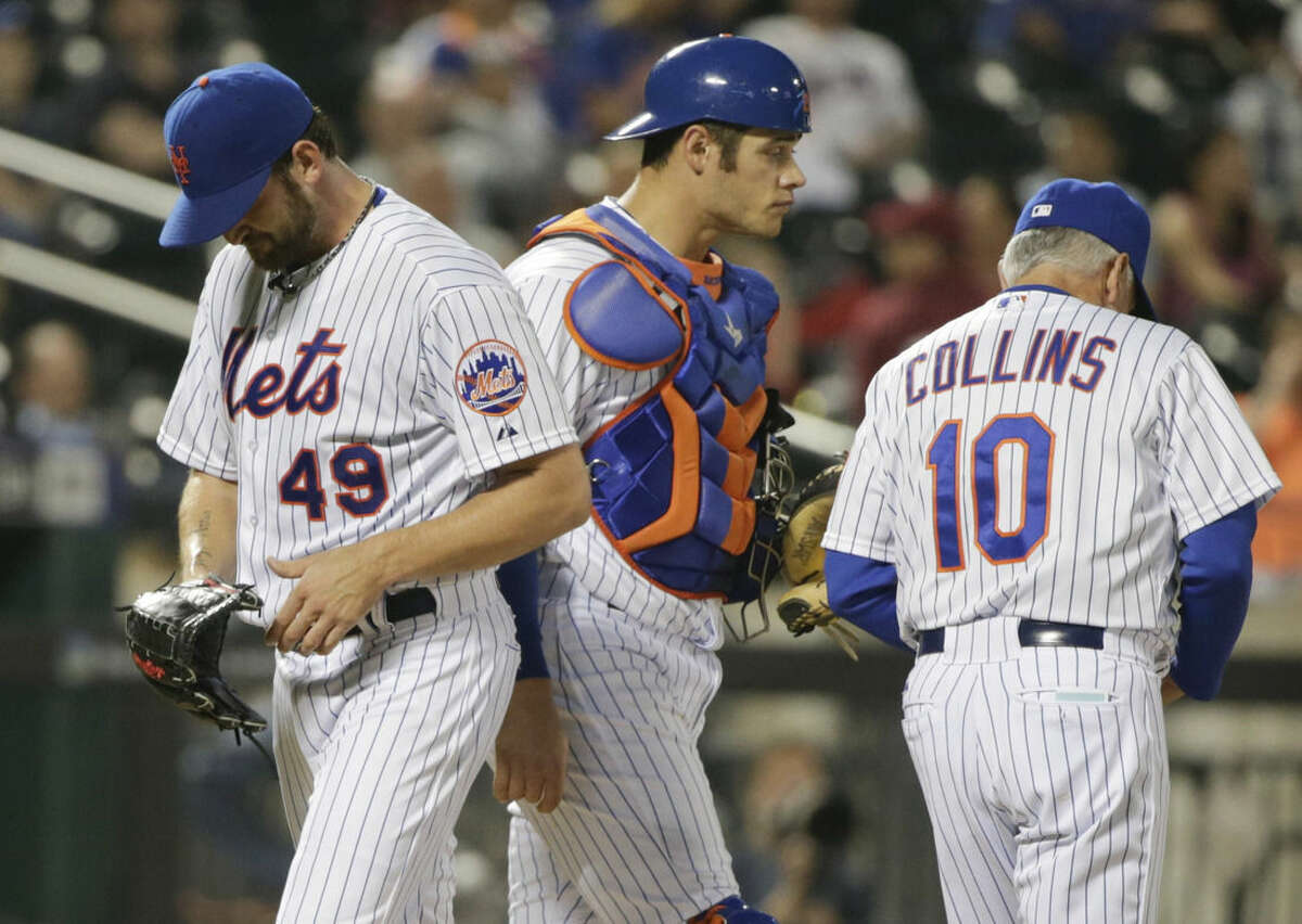 New York Mets starting pitcher Jonathon Niese (49) leaves the baseball game during the sixth inning against the St. Louis Cardinals as catcher Anthony Recker and manager Terry Collins (10) look away Tuesday, May 19, 2015, in New York. (AP Photo/Frank Franklin II)
