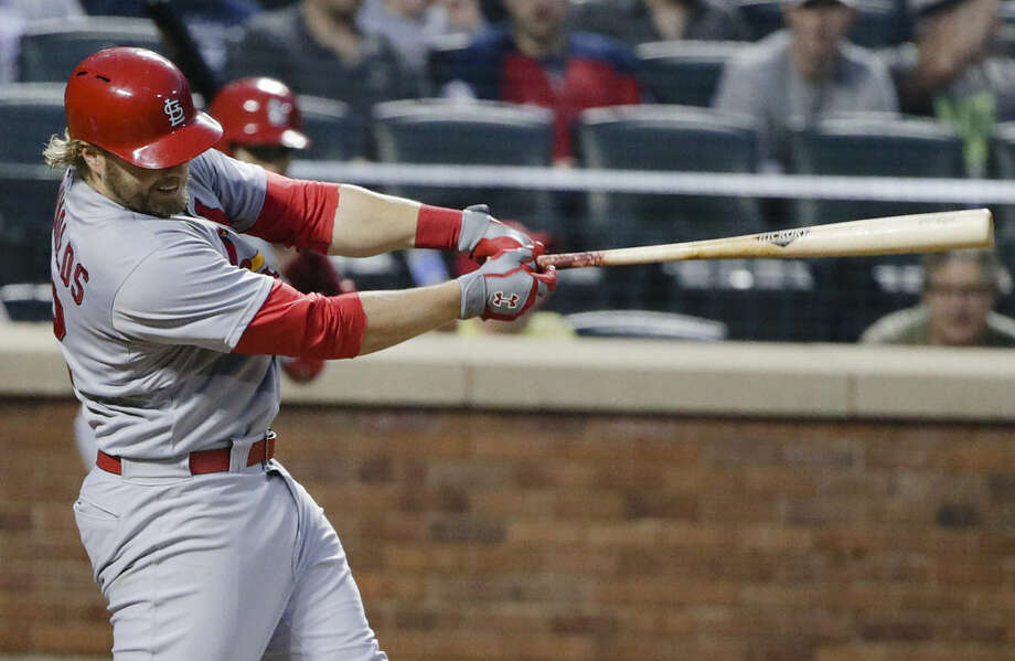St. Louis Cardinals' Mark Reynolds follows through on a home run during the fourth inning of a baseball game against the New York Mets on Tuesday, May 19, 2015, in New York. (AP Photo/Frank Franklin II)