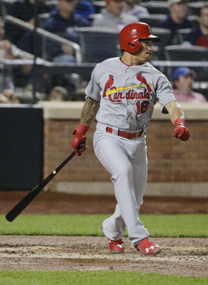 St. Louis Cardinals' Kolten Wong follows through on a two-run double during the sixth inning of a baseball game against the New York Mets on Tuesday, May 19, 2015, in New York. (AP Photo/Frank Franklin II)
