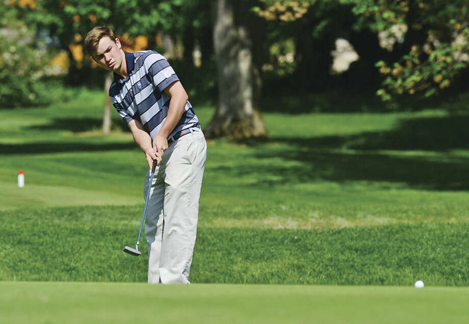 Wilton High School's Richie Williams putts on the first green during their match up against Brien McMahon at Rolling Hills Golf Club in Wilton on Tuesday.Hour photo/Erik Trautmann