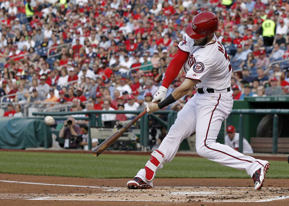 Washington Nationals' Bryce Harper hits a solo home run during the first inning of an interleague baseball game against the New York Yankees at Nationals Park, Tuesday, May 19, 2015, in Washington. (AP Photo/Alex Brandon)
