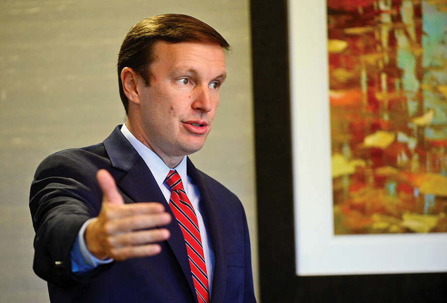 In this file photo, U.S. Sen. Chris Murphy speaks at Wilton League of Women Voters Opening Meeting & Lunch at Rolling Hill Country Club in fall of 2014.