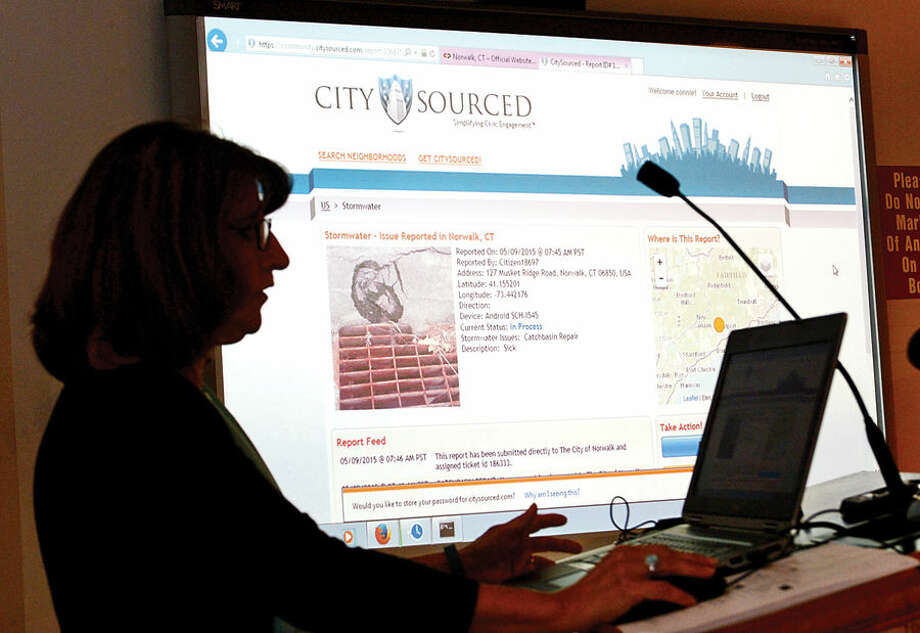 "Hour photo / Erik Trautmann Norwalk Customer Service Manager, Connie Blair, demonstrates the ""Click & Request"" portal for residents to file service requests during an unveiling of the new technology Wednesday at City Hall."