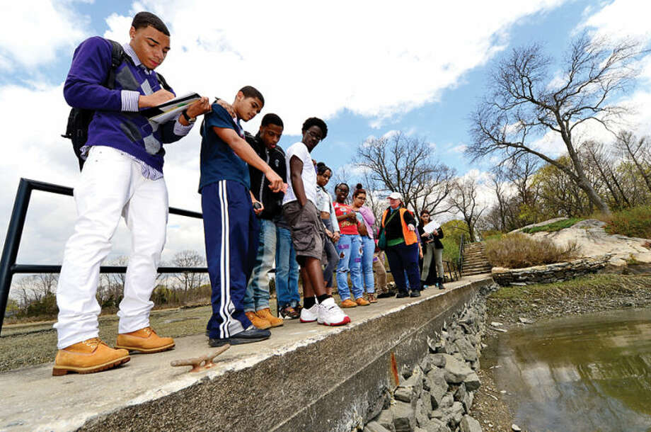 Hour photo / Erik Trautmann Norwalk High School chemistry students tour the Shoendorf, Farm Creek preserve estuary performing enviromental testing Friday morning.