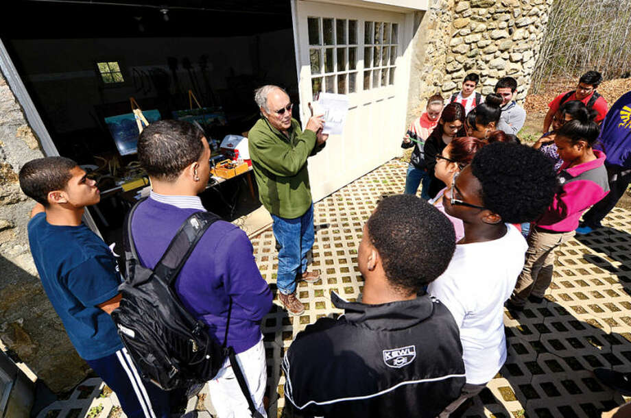 Hour photo / Erik Trautmann Harborwatch director Dick Harris talks to 80 Norwalk High School chemistry students about water quality as the group tours the Shoendorf, Farm Creek preserve estuary performing enviromental testing Friday morning.