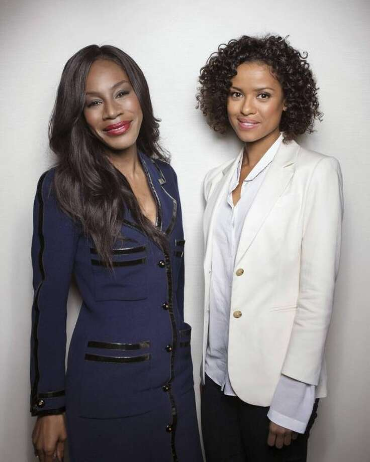 "Director Amma Asante, left, and British actress Gugu Mbatah-Raw pose for a portrait in promotion of their upcoming film, ""Belle,"" on Saturday, April 26, 2014 in New York. (Photo by Taylor Jewell/Invision/AP)"