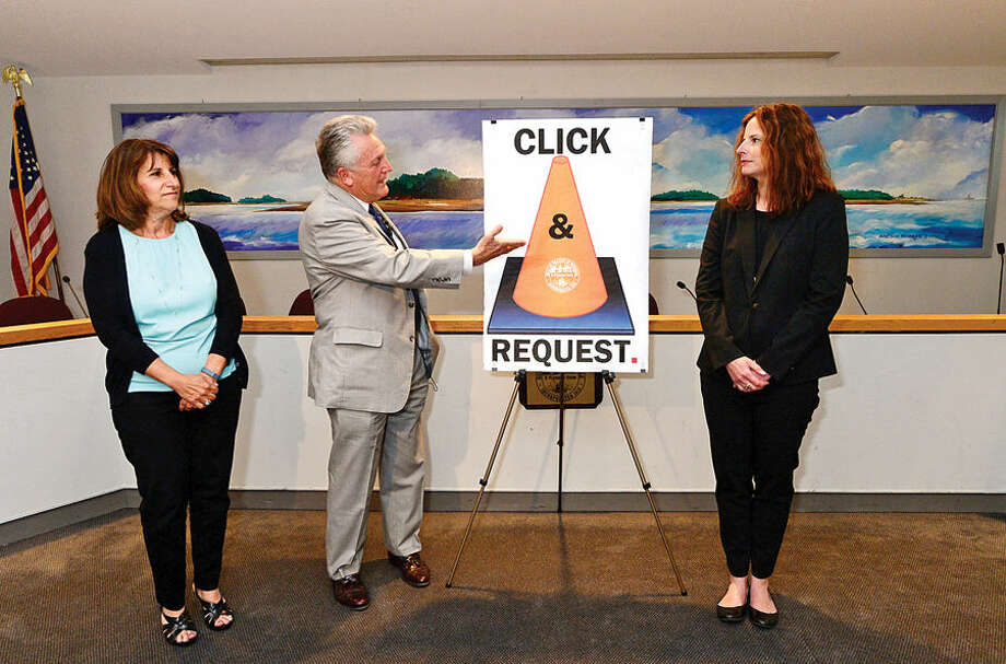 "Hour photo / Erik Trautmann Norwalk Mayor Harry Rilling, Customer Service Manager Connie Blair, and Operations Manager for the DEpartment of Public Works, Lisa Burns, speak on the new ""Click & Request"" portal for residents to file service requests during an unveiling Wednesday at City Hall."