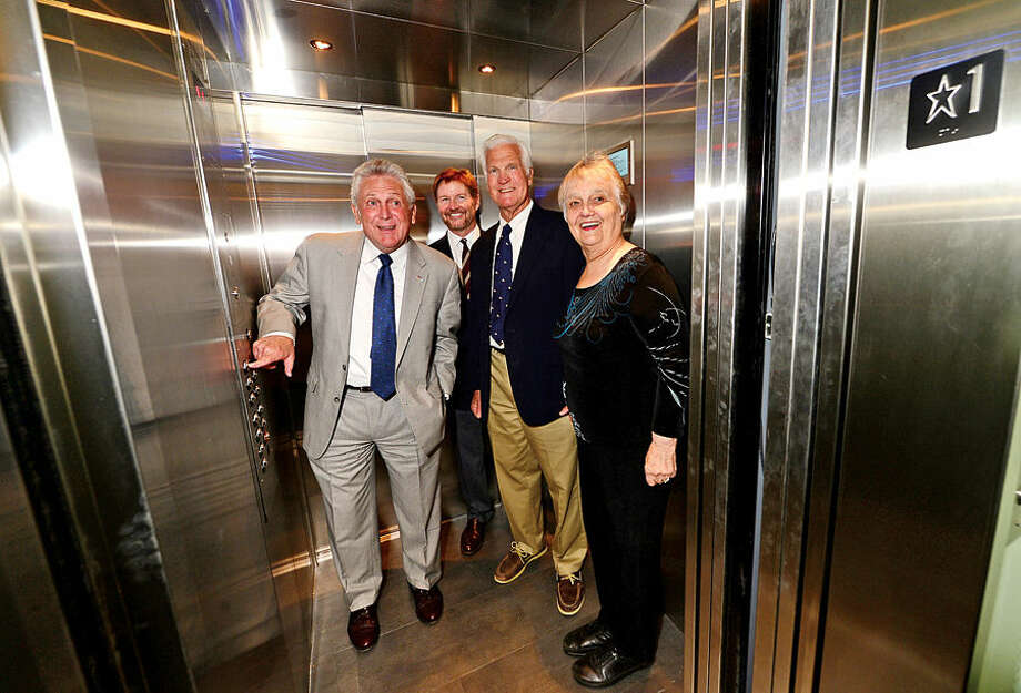 Hour photo / Erik Trautmann Norwalk Mayor, Harry Rilling, President of the Norwalk Historical Commission, David Westmoreland, Lockwood-Mathews Mansion Museum (LMMM) trustee, Port Draper, and Chair of the Board of Trustees for the LMMM, Patsy Brescia take the museum's brand new elevator up during an unveiling and ribbon cutting ceremony Wednesday.