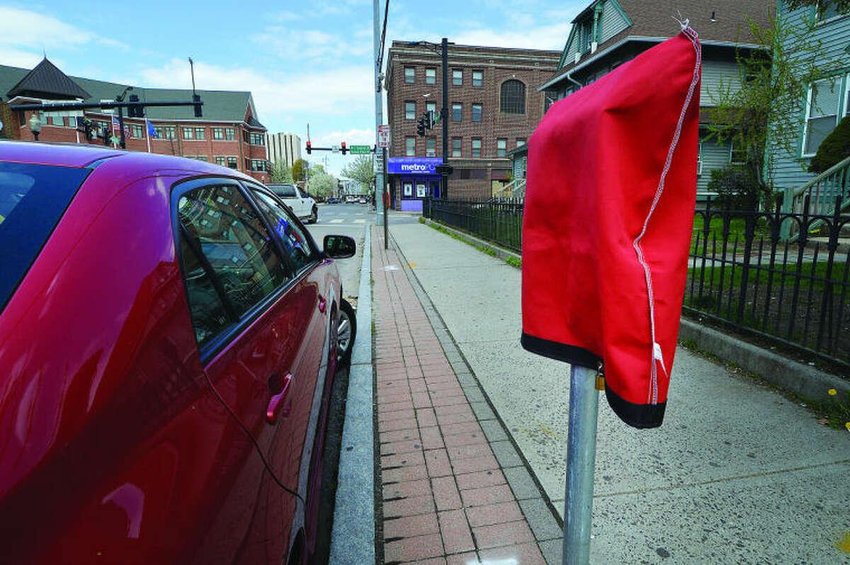 Hour Photo / Alex von Kleydorff Parking Meters installed along So. Main street at Monroe St. in South Norwalk Friday.