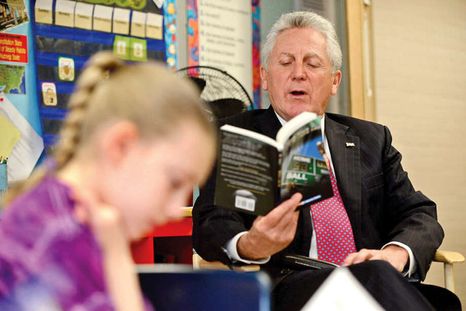 "Hour photo / Erik Trautmann Norwalk Mayor Harry Rilling reads ""Winners Take All"" by Fred Bowen Friday as part of the ""One Book, One School"" intiative where Cranbury Elementary School spent the last few weeks reading the same book."