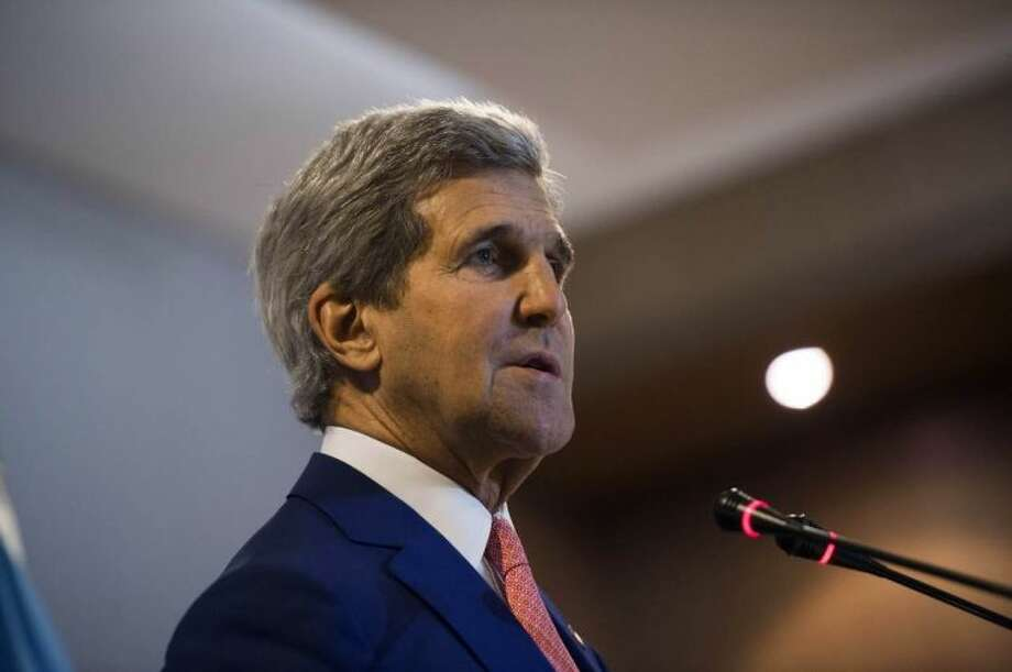 """U.S Secretary of State John Kerry gives a press conference after meetings at the Palais de la Nation in Kinshasa, Democratic Republic of Congo, Sunday, May 4, 2014. The United States is ready to help fund the demobilisation of Democratic Republic of Congo's rebels, a senior US official said on May 3 as Secretary of State John Kerry arrived in the country on the latest leg of an Africa tour. """"I can say categorically that we're ready to support them,"""" the official said when asked if Washington was ready to back the government's demobilisation plan for some 12,000 rebels active in dozens of militias in the country's mineral-rich, restive east, a plan that's estimated to cost some 100 million dollars. (AP Photo/Saul Loeb, pool)"""