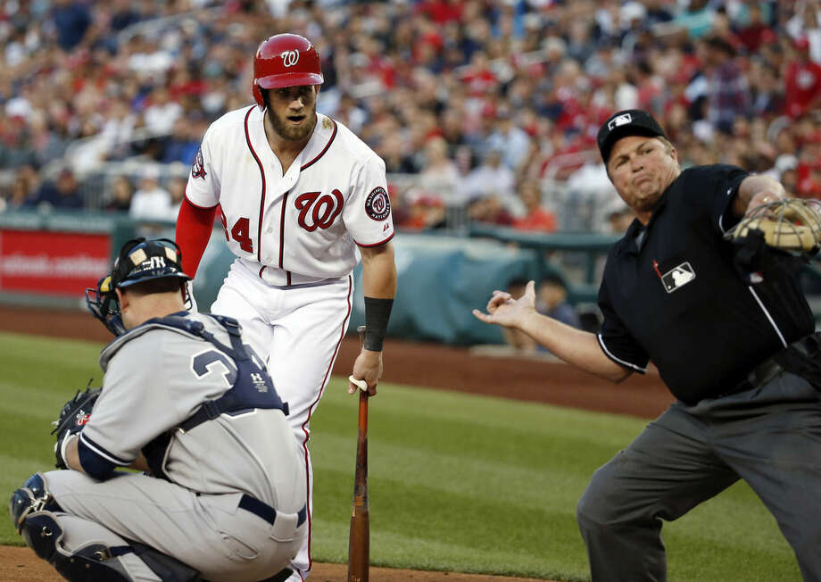 Washington Nationals' Bryce Harper (34) is ejected by home plate umpire Marvin Hudson during the third inning of a baseball game against the New York Yankees at Nationals Park, Wednesday, May 20, 2015, in Washington. Nationals manager Matt Williams was later ejected by Hudson. (AP Photo/Alex Brandon)