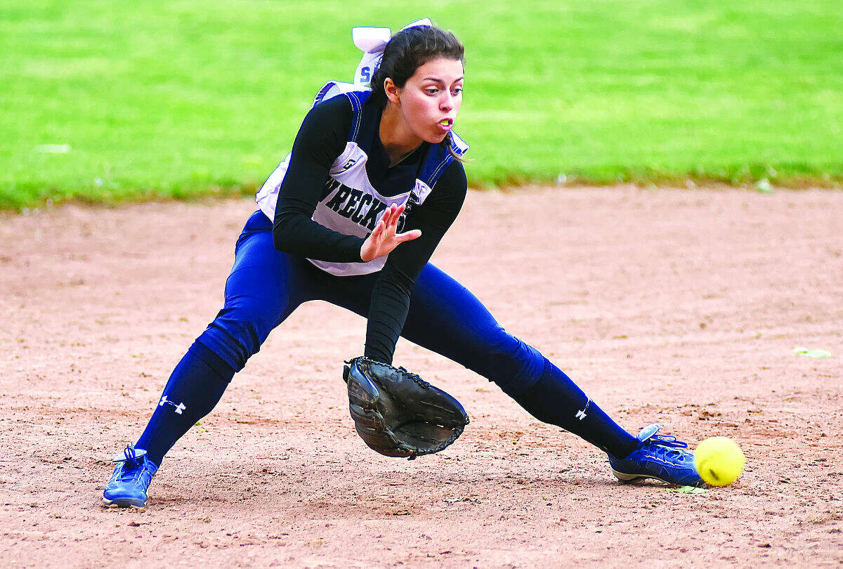 Hour photo/John Nash - Staples shorstop Gabby Perry gets ready to scoop up a ground ball during Wednesday's FCIAC softball game against Norwalk.
