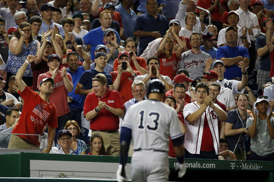 Fans jeer at New York Yankees' Alex Rodriguez (13) after he struck out during the ninth inning of an interleague baseball game against the Washington Nationals at Nationals Park, Tuesday, May 19, 2015, in Washington. The Nationals won 8-6 in 10 innings. (AP Photo/Alex Brandon)