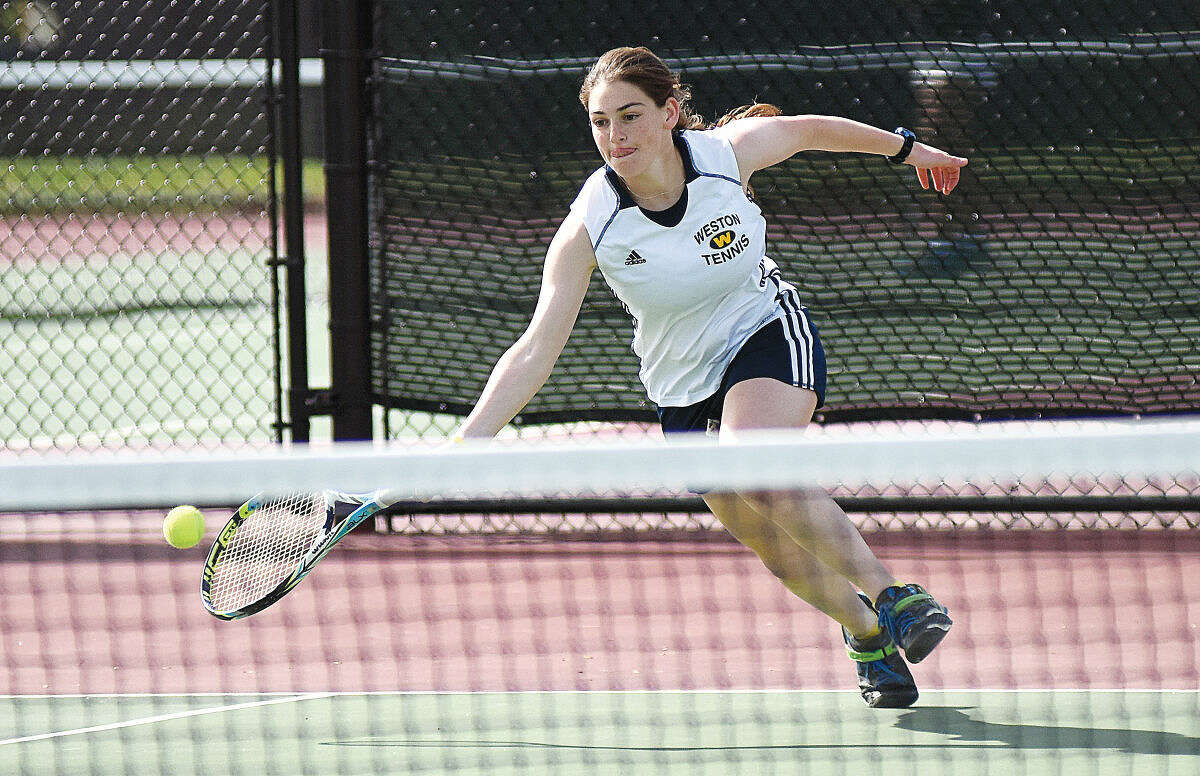 Weston's Andi Rosenblatt, playing in the No. 1 doubles match with Sarah Greisman, lunges for a shot during Wednesday's SWC championship match against Joel Barlow in Redding. (Hour photo/John Nash)