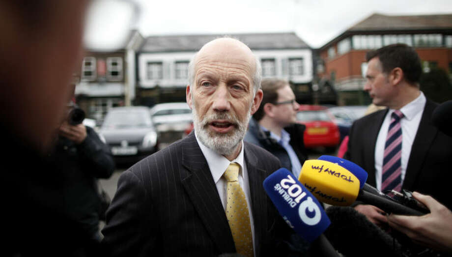 Northern Ireland Minister of Justice David Ford speaks to the media outside Antrim Police station, Northern Ireland, Friday, May, 2 2014. Police continue to question the Sinn Fein leader Gerry Adams at Antrim police station about the 1972 murder of Jean McConville. (AP Photo/Peter Morrison)