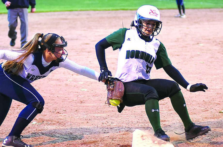 Hour photo/John Nash - Norwalk's Sam Troetti, right, is tagged out at third base by Staples' Lily Tofel during Wednesday's FCIAC softball game at the Greens Farms Elementary School in Westport. Troetti had stolen second base and was trying to take an extra base after an error when she was thrown out.