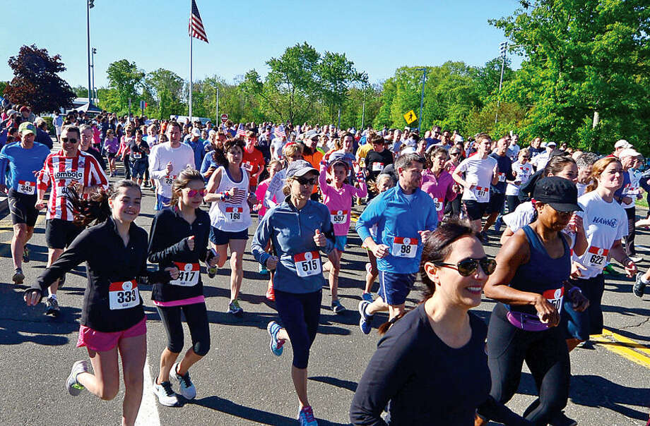 Hour photo / Erik Trautmann Hundred of participants start out on the annual Weston Memorial Day 5k Road Race Saturday.