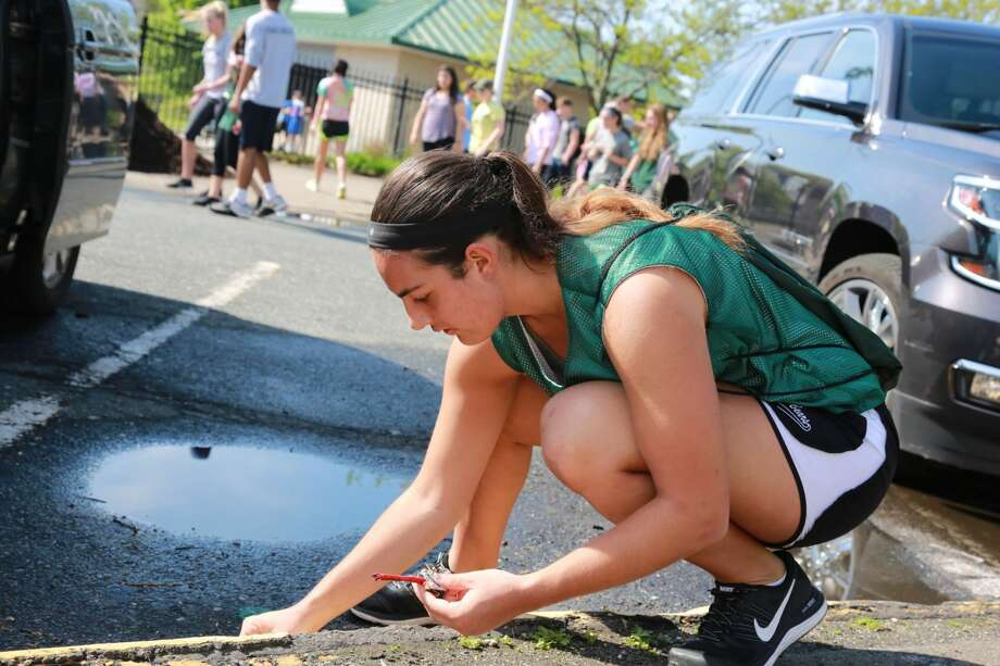 Norwalk High School hosted the 17th annual Campus Clean Up on May 14, 2016. Teachers and students gathered at the school to clean up the grounds and enhance the gardens. The morning ended with a tree planting. The Campus Clean Up is funded by community donations. Were you SEEN?