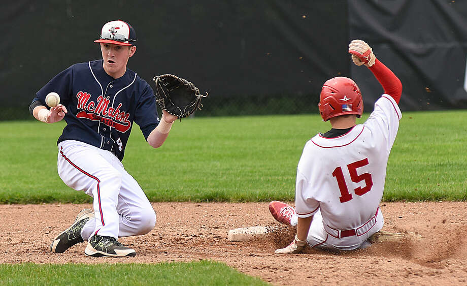 Brien McMahon shortstop Chris Giordano, left, waits for a late throw as Greenwich's Ryan King safely steals second base during Saturday's FCIAC baseball game in Greewich. The host Cardinals won, 7-1, eliminating the Senators from league playoff contention.