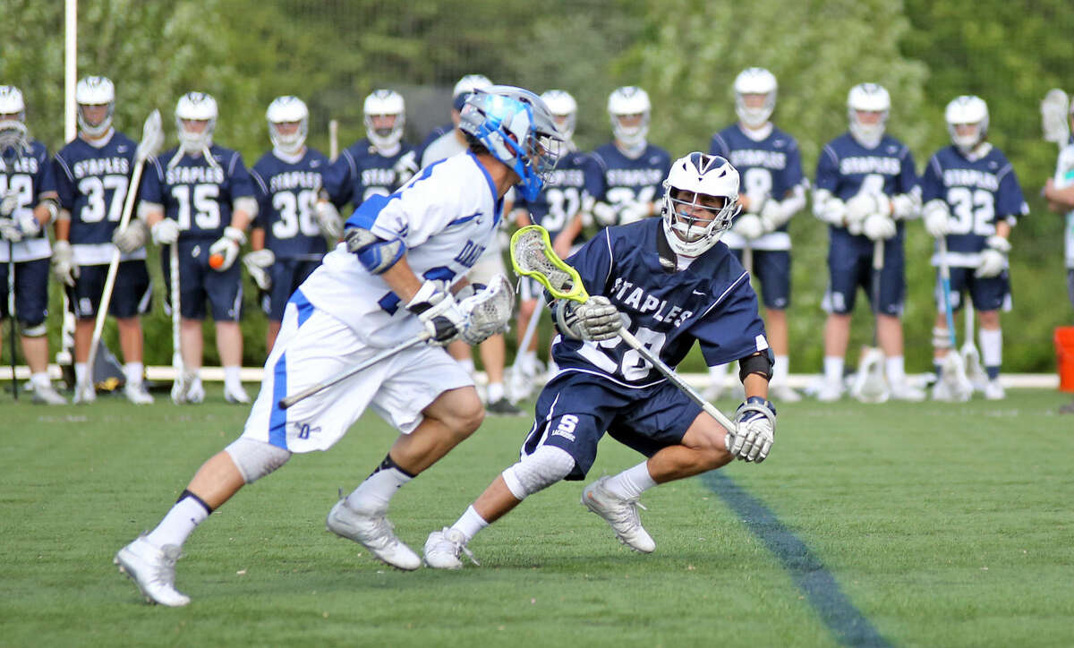 Staples #28, Ben Schwaeber, trys to get the ball during an away game against Darien Friday afternoon. Hour Photo / Danielle Calloway