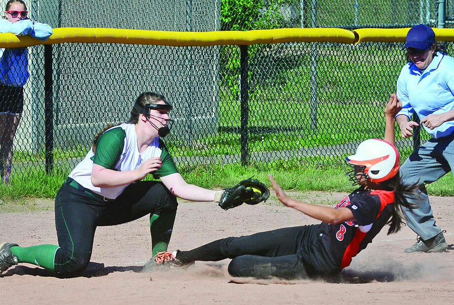 Hour photo / Erik Trautmann Norwalk High School's Dina DiBlasio tages out Stamford's Sarah Staley during their FCIAC semi-final game in Stamford Saturday.