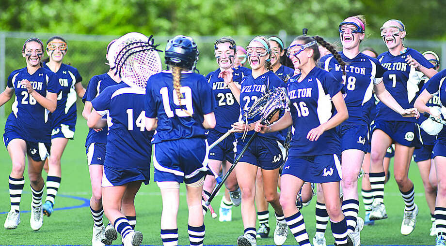 Wilton celebrates its come from behind win over Staples in the FCIAC quarterfinals on Friday. (John Nash/Hour photo)