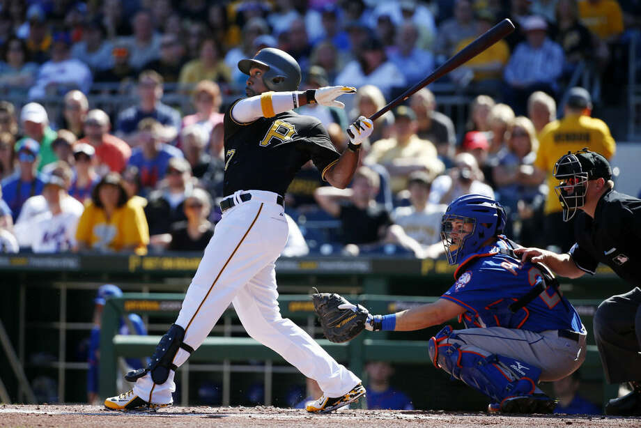 Pittsburgh Pirates' Andrew McCutchen hits a two-run home run off New York Mets starting pitcher Matt Harvey in the first inning of a baseball game in Pittsburgh, Saturday, May 23, 2015. (AP Photo/Gene J. Puskar)