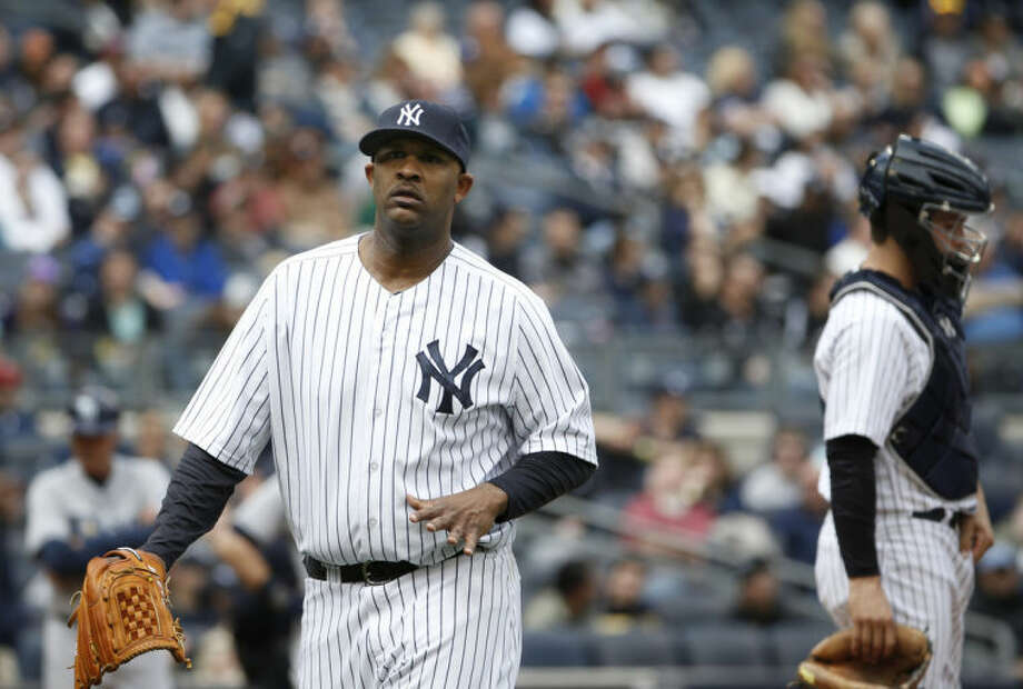 New York Yankees starting pitcher CC Sabathia flexes his pitching hand while leaving a baseball game after giving up a fourth-inning double to Tampa Bay Rays' Wil Myers at Yankee Stadium in New York, Sunday, May 4, 2014. (AP Photo/Kathy Willens)