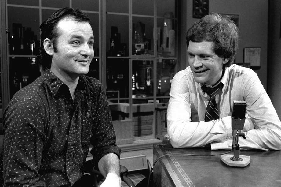"FILE - In this Feb. 1, 1982 file photo, host David Letterman, right, and guest Bill Murray appear at the taping of the debut of ""Late Night with David Letterman"" in New York. Murray's 44th and final appearance Tuesday, May 19, 2015, will mark the end of late-night television's most unique and enduring host-guest relationships. After 33 years in late night and 22 years hosting CBS' ""Late Show,"" Letterman will retire on May 20. (AP Photo/Nancy Kaye, File)"