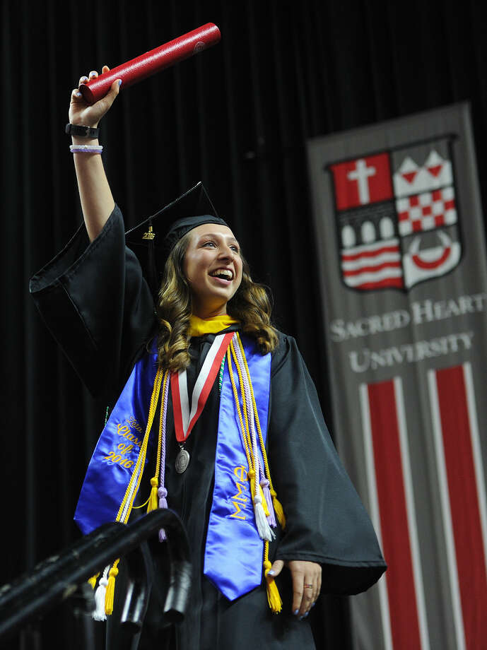 Grad Victoria Jakic celebrates after receiving her diploma during Sacred Heart University's graduation at the Webster Bank Arena in Bridgeport, Conn. on Sunday, May 15, 2016.