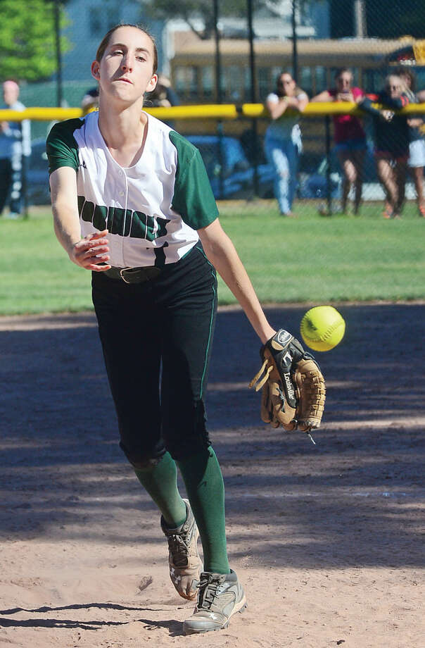 Hour photo / Erik Trautmann #7 Ali Brown pitches against Stamford during their FCIAC semi-final game in Stamford Saturday.