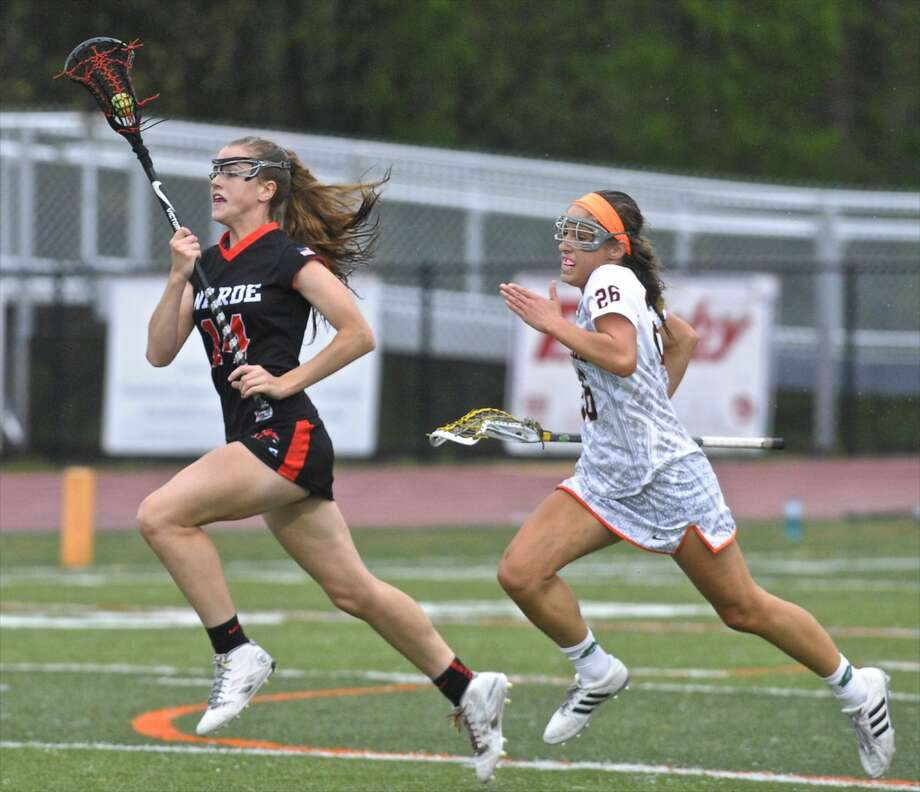Fairfield-Ward's Libby McKenna (14) sprints down the field chased by Ridgefield's Ann Hage (26) in the girls lacrosse game between Fairfield-Ward and Ridgefield high school, on Friday night, May 13, 2016, at Ridgefield High School, in Ridgefield, Conn.