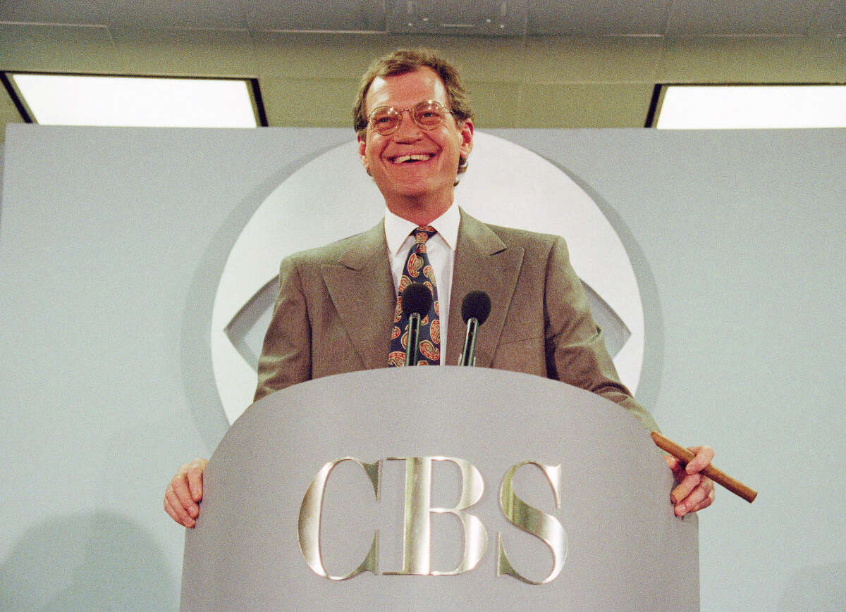 FILE - In this Jan. 14, 1993 file photo, talk-show host David Letterman announces his move from NBC to CBS at a news conference at CBS Studios in New York. Letterman's show