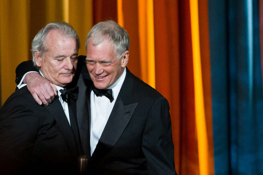 "FILE - In this March 26, 2011 file photo, Bill Murray, left, and David Letterman appear at the ""The Comedy Awards"" presented by Comedy Central in New York. After 33 years in late night and 22 years hosting CBS' ""Late Show,"" Letterman will retire on May 20. (AP Photo/Charles Sykes, File)"