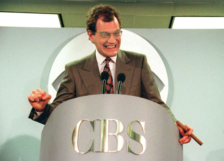 "FILE - This Jan. 15, 1993 file photo shows talk-show host David Letterman announces his new contract with CBS television for his new show ""The Late Show with David Letterman,"" in New York. Letterman will retire from hosting on May 20, 2015. (AP Photo/Alex Brandon, File)"