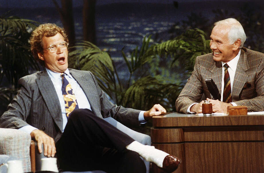 "FILE - In this Aug. 30, 1991 file photo, ""Late Night with David Letterman"" host David Letterman, left, appears with host Johnny Carson during taping of ""The Tonight Show,"" at the NBC Studio in Burbank, Calif. After 33 years in late night and 22 years hosting CBS' ""Late Show,"" Letterman will retire on May 20. (AP Photo/Bob Galbraith, File)"
