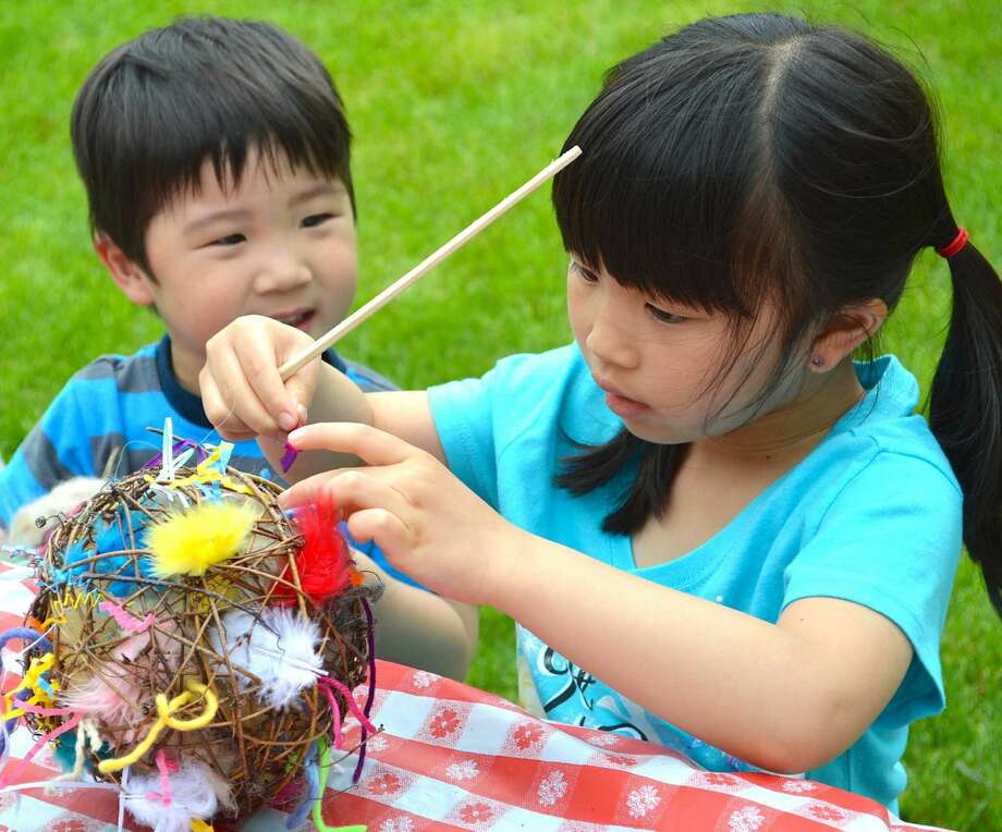 Andrew Hartono, 3, of Westport, and sister Natalie, 6, fashion a nesting ball for birds during GreenDay at Wakeman Town Farm.